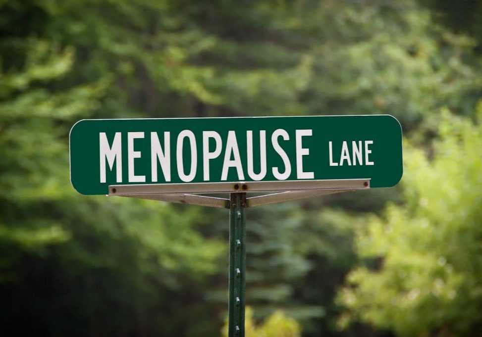 Menopause Lane street sign indicating a woman or women with a sense of humor live there